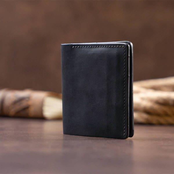 Функциональное тонкое портмоне GRANDE PELLE 11326 Черное