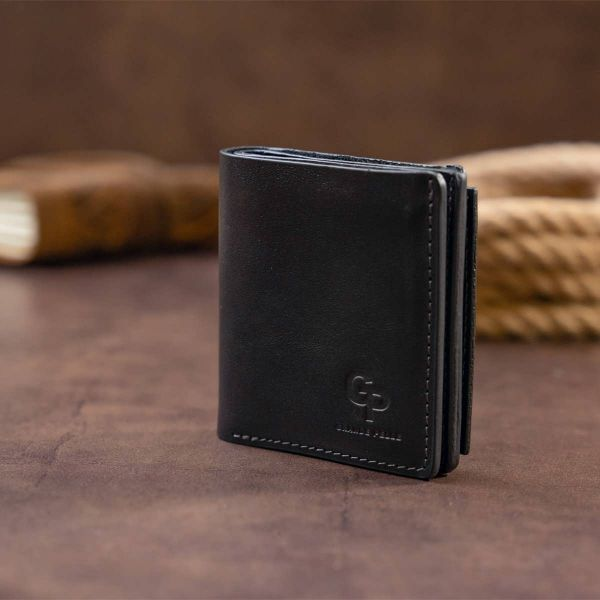Вертикальное глянцевое портмоне с накладной монетницей GRANDE PELLE 11329 Черное