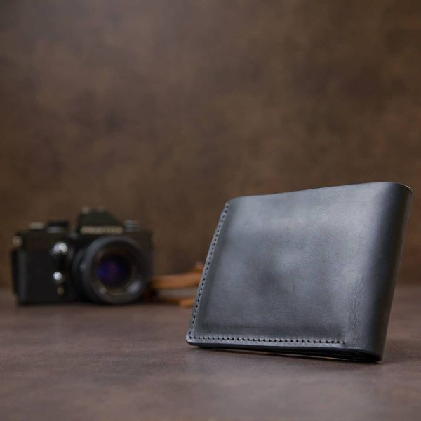 Матовое кожаное портмоне GRANDE PELLE 11457 черный